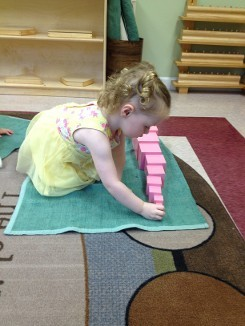 Girl Building Pink Tower