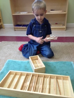 Boy Playing with Spindle Box